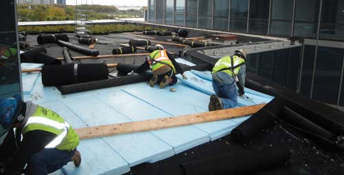 CRC Professional contractors and Local 11 roofers work above delicate roof membranes building watertight roofs.